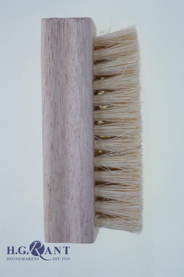 Fibre filled nail brush